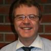 Mr Alastair Magill